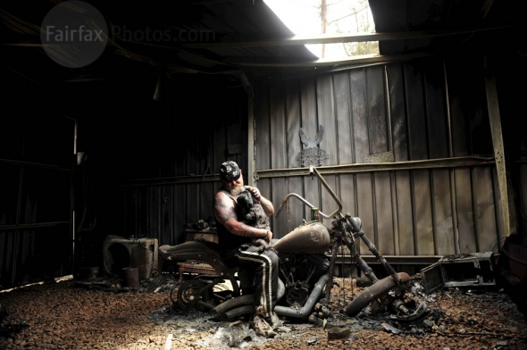 Bushfires 2009. Flowerdale residents returned to the remains of their burnt properties. Seen here Rob Greig with his prized Harley Davidson  now a twisted wreck in his garage in Flowerdale. Rob plans to rebuild his house . Photo by Jason South . THE AGE . 11th February 2009 .