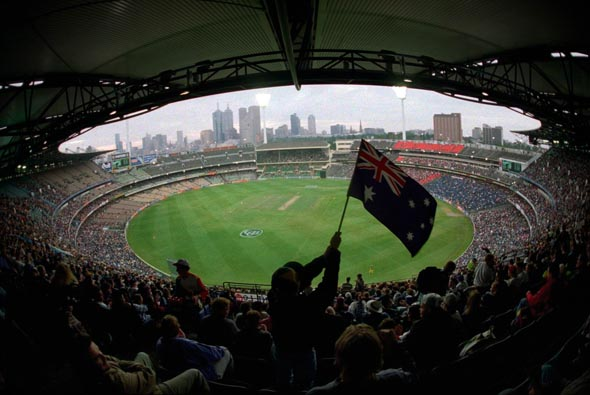 100 Years of Australian Cricket. A young cricket fan waves an Australian Flag among spectators in the Great Southern Stand at the Melbourne Cricket Ground, 7 December 1996.THE AGE SPORT Photograph by CRAIG SILLITOE
