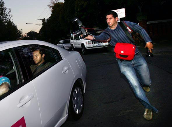Photographer chases Ian Thorpe in a FINA car in Akland street St Kilda  Photograph By Craig Sillitoe/The Sunday Age