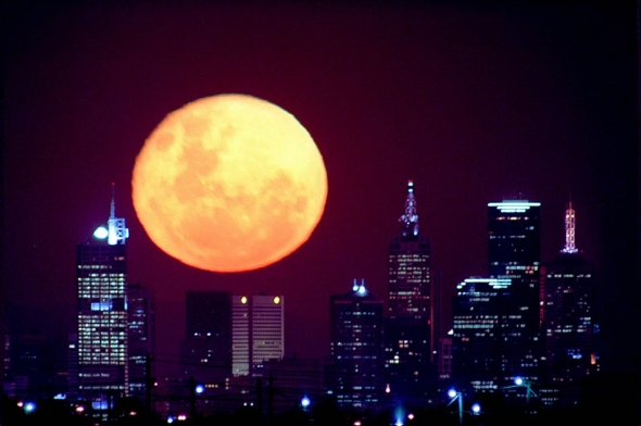 Moon over Melbourne skyline. Pic By Craig Sillitoe/The Sunday Age