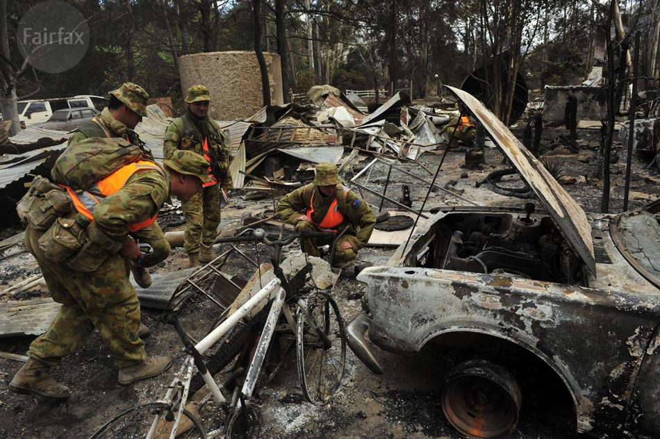 BUSHFIRE 2009 Photo shows members of the Army's Victorian Search Task Group inspecting properties and looking for bodies in Flowerdale. Photo by Jason South for THE AGE 10th February 2009